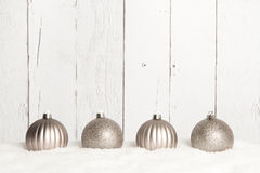 Four silver Christmas decoration balls Stock Images