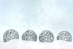 Four silver Christmas ornaments Royalty Free Stock Image