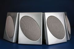 Four silver loudspeakers Stock Image