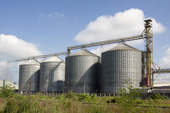 Four silver silos Stock Photos