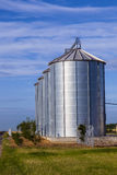 Four silver silos Stock Photography