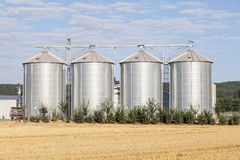 Four silver silos in rural landscape Royalty Free Stock Photography