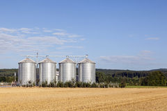 Four silver silos in rural landscape Royalty Free Stock Photo