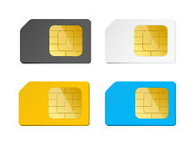 Four sim cards black, white, blue, yellow Royalty Free Stock Photography