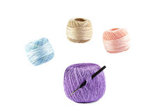 Four skeins of yarn and hook Royalty Free Stock Photography