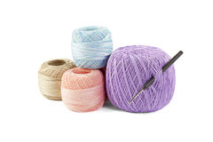 Four skeins of yarn and hook Stock Photo