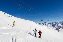Four skiers at ski slope Stock Image