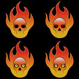 Four Skulls In Fire. Four symbols of burning skulls Stock Images