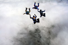 Four Skydivers building a star formation Stock Images