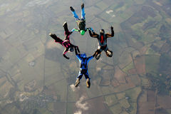 Four skydivers doing formations Stock Images