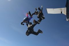 Four skydivers exit a plane Royalty Free Stock Photos