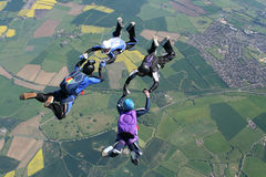 Four skydivers in freefall. Doing formations Royalty Free Stock Image