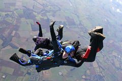 Four skydivers in freefall. On a sunny day Stock Image