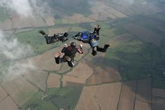 Four skydivers in freefall. Doing formations Stock Images