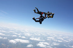 Four skydivers after the have exit an airplane. On a bright sunny day Stock Photos