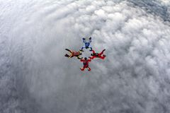 Four skydivers are in the sky. royalty free stock images
