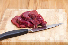 Four Slice Beef Tenderloin on Cutting Board Royalty Free Stock Photos