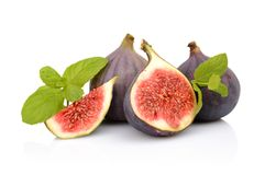 Four sliced figs isolated with mint on white background Royalty Free Stock Photos
