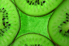 Four slices kiwi fruit on green Stock Photos