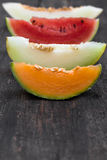 Four slices of melons Royalty Free Stock Images