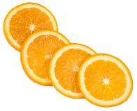 Four slices of orange. In diagonal row isolated on white Stock Photos