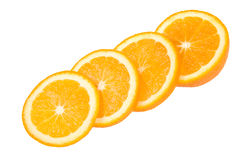 Four slices of orange. In diagonal row isolated on white Royalty Free Stock Images