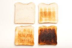 Four slices of toasted bread, white to black Stock Photo