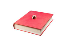 Four small books on the big one Royalty Free Stock Photo