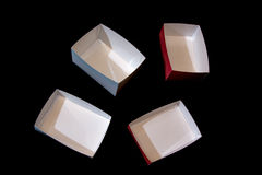 Four small boxes made of laminated paper Stock Images