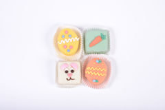 Four small bright Easter cakes in a form of bunny and eggs Royalty Free Stock Photo