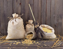 Burlap bags with broomstick Royalty Free Stock Photography