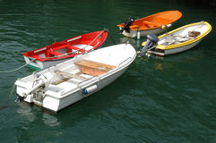 Four small colorful boats Royalty Free Stock Photo