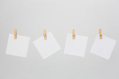 Four White Notes on Clotheswire Stock Image