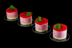 Four small redcurrant cakes decorated with berries Stock Photography