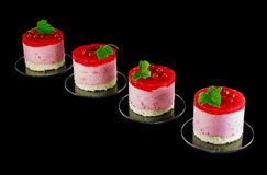 Four small redcurrant cakes decorated with berries Royalty Free Stock Photo
