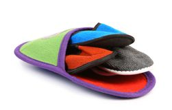 Four small slippers inside a big Stock Image