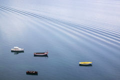 Four small wooden boats on the lake Royalty Free Stock Image