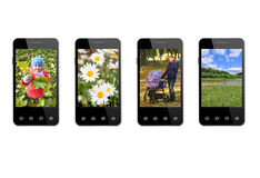 Four smart-phones with colored images isolated Stock Photos