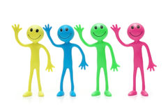 Four Smilies of various colours Royalty Free Stock Photography