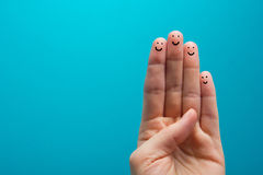 Four smiling fingers that are very happy to be friends Stock Images