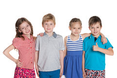 Four smiling little friends Stock Photography