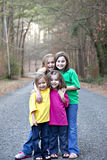Four smiling little girls in street Stock Photo