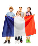 Four smiling multiethnic students from France Stock Images
