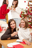 Four smiling women on Christmas Stock Images