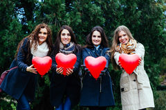 Four smiling women showing hearts Royalty Free Stock Photos