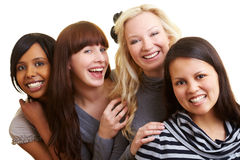 Four smiling young women royalty free stock image