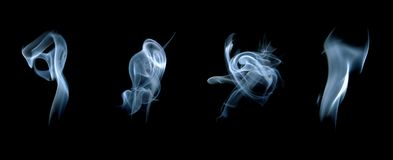 Four smoke curls. On black background Stock Image