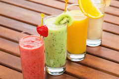 Four smoothie on wooden table Royalty Free Stock Photo