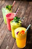 Four smoothies with great taste and instant energy boost packed with essential nutrients for body nourishment. Just living healthy royalty free stock photo