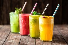 Four smoothies with great taste and instant energy boost packed with essential nutrients for body nourishment. Just living healthy stock image